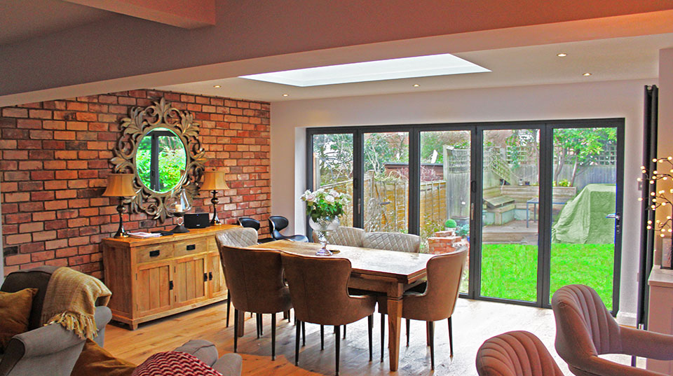 Witherford Croft Solihull interior view of dining extension showing roof light and folding doors